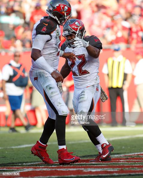Running back Doug Martin of the Tampa Bay Buccaneers celebrates his touchdown with quarterback Jameis Winston during the fourth quarter of an NFL...