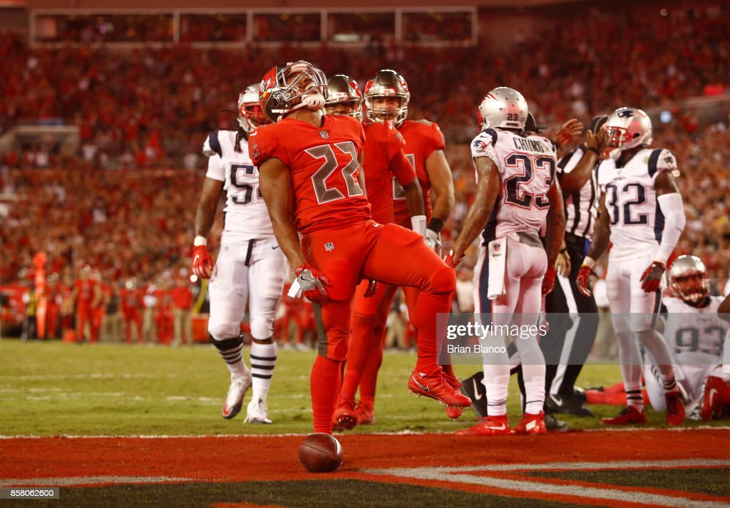 Running back Doug Martin #22 of the Tampa Bay Buccaneers celebrates in the end zone following a 1-yard rush for a touchdown during the second quarter of an NFL football game against the New England Patriots on October 5, 2017 at Raymond James Stadium in Tampa, Florida.