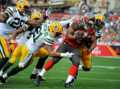 Running back Doug Martin of the Tampa Bay Buccaneers is tackled by free safety Ha Ha ClintonDix of the Green Bay Packers and inside linebacker Sam...