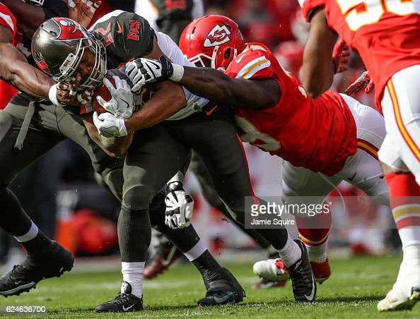Running back Doug Martin of the Tampa Bay Buccaneers is tackled by defensive tackle Rakeem NunezRoches of the Kansas City Chiefs at Arrowhead Stadium...