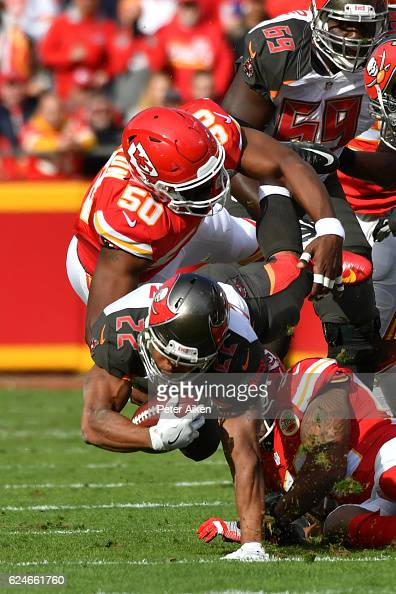 Running back Doug Martin of the Tampa Bay Buccaneers is tackled by outside linebacker Justin Houston of the Kansas City Chiefs after a rush at...