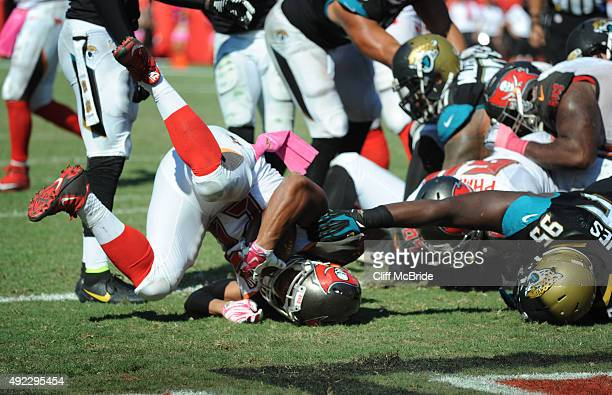 Running back Doug Martin of the Tampa Bay Buccaneers lands in the endzone for a touchdown against the Jacksonville Jaguars in the fourth quarter at...