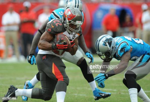 Running back Doug Martin of the Tampa Bay Buccaneers runs against Carolina Panthers at Raymond James Stadium on September 7 2014 in Tampa Florida