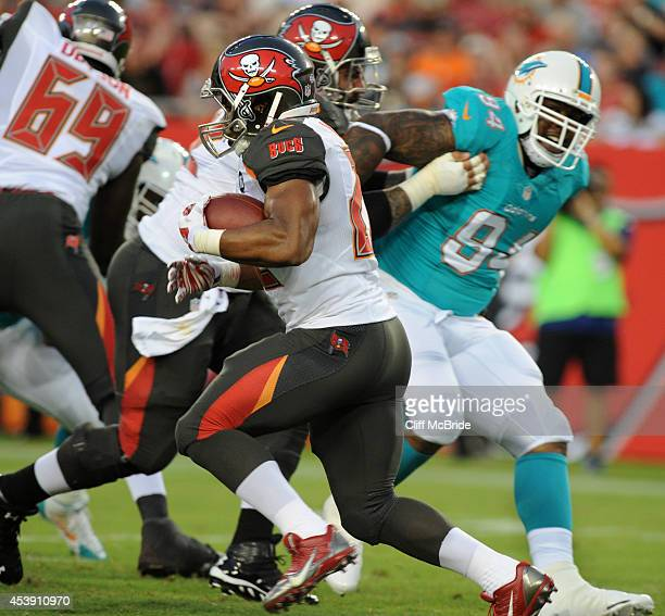 Running back Doug Martin of the Tampa Bay Buccaneers runs against the Miami Dolphins at Raymond James Stadium during a preseason game on August 16...