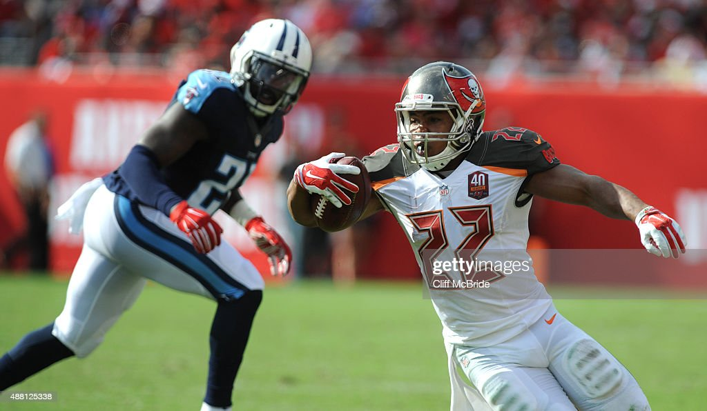 Running back Doug Martin #22 of the Tampa Bay Buccaneers runs against the Tennessee Titans in the 2nd quarter at Raymond James Stadium on September 13, 2015 in Tampa, Florida.
