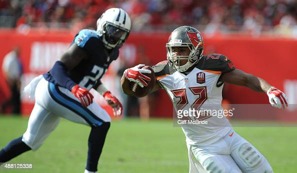 Running back Doug Martin of the Tampa Bay Buccaneers runs against the Tennessee Titans in the 2nd quarter at Raymond James Stadium on September 13...