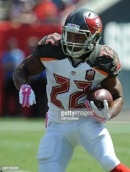 Running back Doug Martin of the Tampa Bay Buccaneers runs against the Jacksonville Jaguars at Raymond James Stadium on October 11 2015 in Tampa...