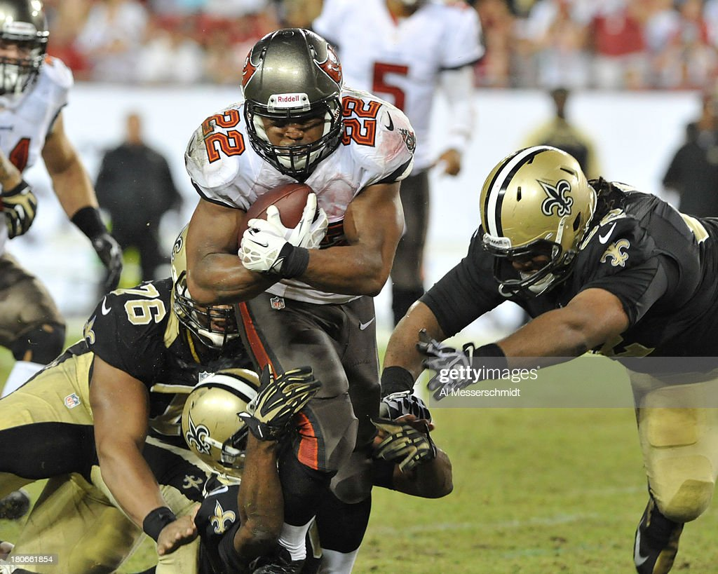 Running back Doug Martin #22 of the Tampa Bay Buccaneers runs for a gain in the 4th quarter against the New Orleans Saints September 15, 2013 at Raymond James Stadium in Tampa, Florida.
