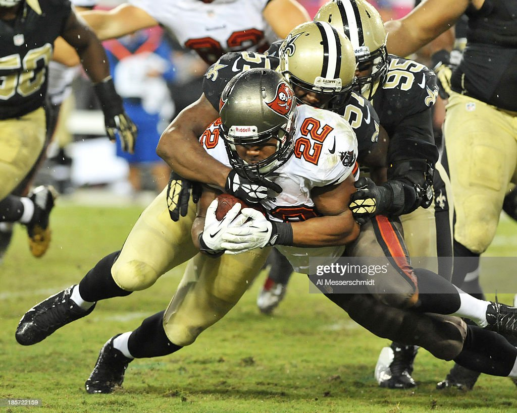 Running back Doug Martin #22 of the Tampa Bay Buccaneers runs for a gain against the New Orleans Saints September 15, 2013 at Raymond James Stadium in Tampa, Florida. The Saints won 16 - 14.