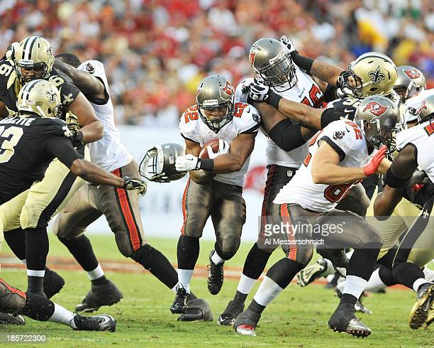 Running back Doug Martin of the Tampa Bay Buccaneers runs for a gain against the New Orleans Saints September 15 2013 at Raymond James Stadium in...