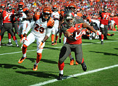 Running back Doug Martin of the Tampa Bay Buccaneers runs for a TD against the Cincinnati Bengals in the second quarter at Raymond James Stadium on...