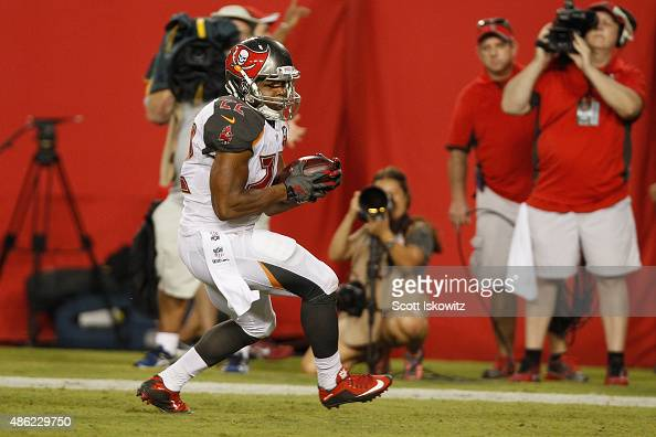 Running back Doug Martin of the Tampa Bay Buccaneers runs in the end zone during the preseason game between the Tampa Bay Buccaneers and the...