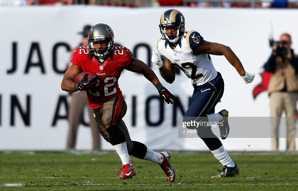 Running back Doug Martin #22 of the Tampa Bay Buccaneers runs the ball as defender Trumaine Johnson #22 of the St. Louis Rams trails during the game at Raymond James Stadium on December 23, 2012 in Tampa, Florida.