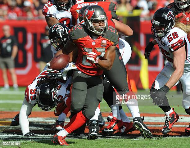 Running back Doug Martin of the Tampa Bay Buccaneers runs the ball in the second quarter against the Atlanta Falcons at Raymond James Stadium on...