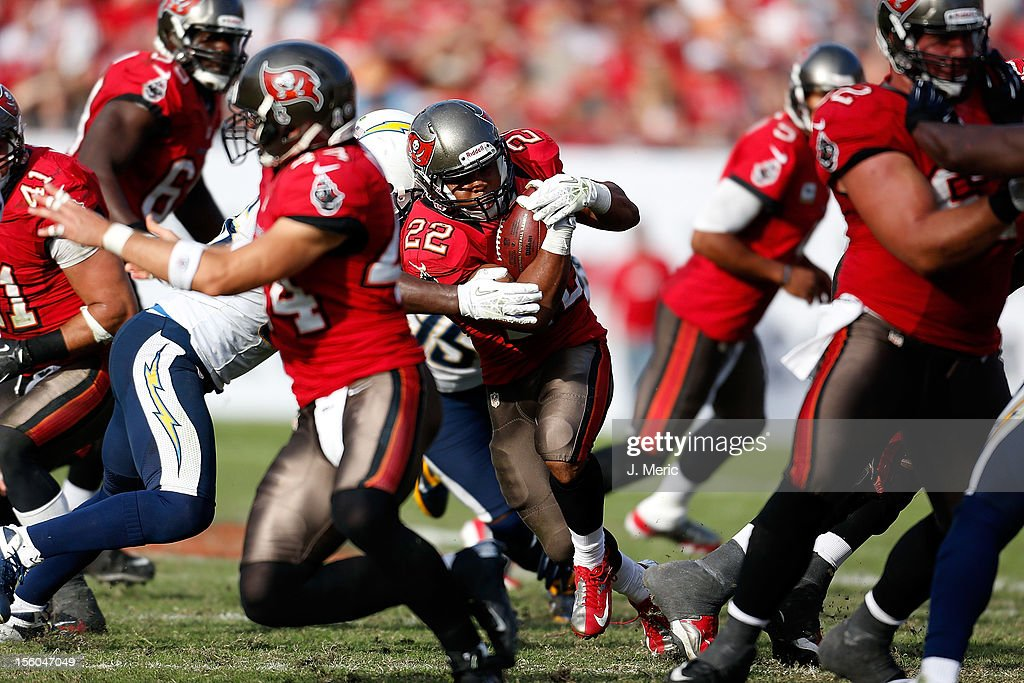 Running back Doug Martin #22 of the Tampa Bay Buccaneers runs the ball against the San Diego Chargers during the game at Raymond James Stadium on November 11, 2012 in Tampa, Florida.