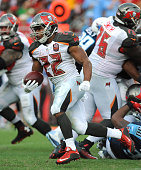 Running back Doug Martin of the Tampa Bay Buccaneers runs with the ball against the at Raymond James Stadium on September 13 2015 in Tampa Florida