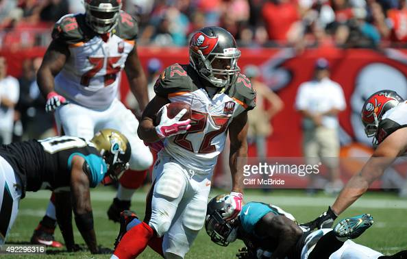 Running back Doug Martin of the Tampa Bay Buccaneers runs with the ball in the second quarter against the Jacksonville Jaguars at Raymond James...