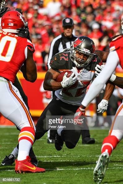 Running back Doug Martin of the Tampa Bay Buccaneers rushes through a hole in the line against the Kansas City Chiefs at Arrowhead Stadium during the...