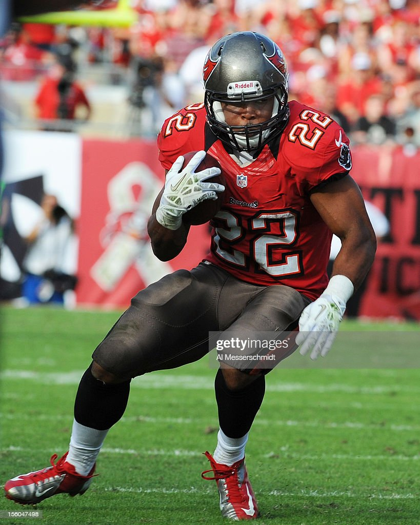 Running back <a gi-track='captionPersonalityLinkClicked' href=/galleries/search?phrase=Doug+Martin+-+American+Football+Running+Back&family=editorial&specificpeople=9693143 ng-click='$event.stopPropagation()'>Doug Martin</a> #22 of the Tampa Bay Buccaneers rushes upfield in the fourth quarter against the San Diego Chargers November 11, 2012 at Raymond James Stadium in Tampa, Florida. Tampa won 34 - 24.