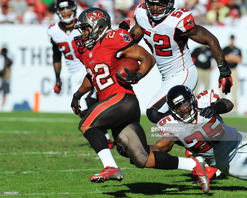 Running back <a gi-track='captionPersonalityLinkClicked' href=/galleries/search?phrase=Doug+Martin+-+American+Football+Running+Back&family=editorial&specificpeople=9693143 ng-click='$event.stopPropagation()'>Doug Martin</a> #22 of the Tampa Bay Buccaneers rushes upfield against the Atlanta Falcons November 25, 2012 at Raymond James Stadium in Tampa, Florida. The Falcons won 24 - 23.