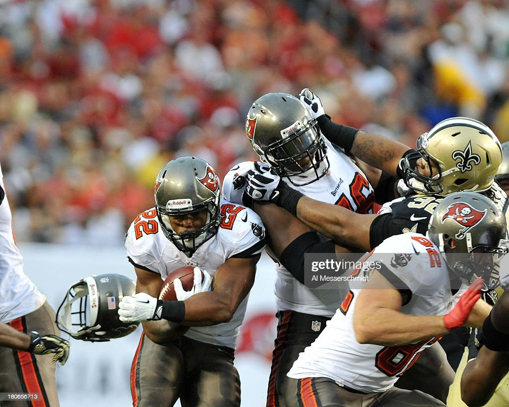 Running back Doug Martin #22 of the Tampa Bay Buccaneers rushes upfield against the New Orleans Saints September 15, 2013 at Raymond James Stadium in Tampa, Florida.