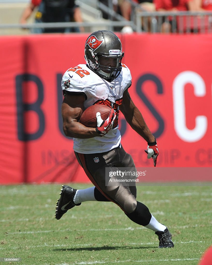 Running back Doug Martin #22 of the Tampa Bay Buccaneers rushes upfield against the Arizona Cardinals September 29, 2013 at Raymond James Stadium in Tampa, Florida.