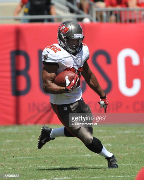 Running back Doug Martin of the Tampa Bay Buccaneers rushes upfield against the Arizona Cardinals September 29 2013 at Raymond James Stadium in Tampa...