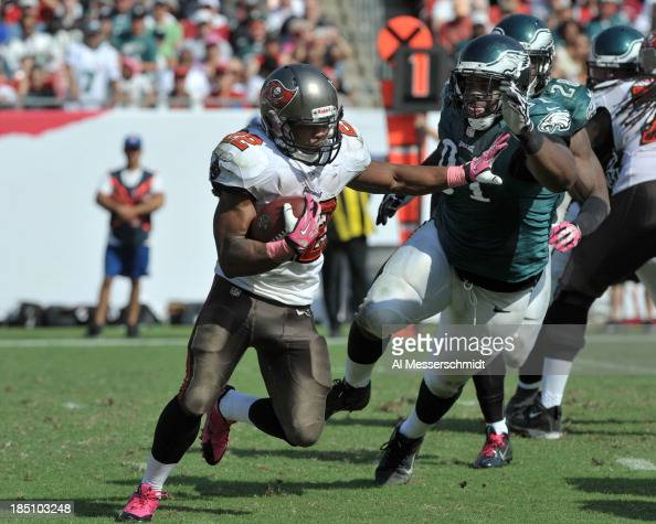 Running back Doug Martin of the Tampa Bay Buccaneers rushes upfield against the Philadelphia Eagles October 13 2013 at Raymond James Stadium in Tampa...