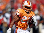 Running back Doug Martin of the Tampa Bay Buccaneers scores a first quarter touchdown against the New Orleans Saints during the game at Raymond James...