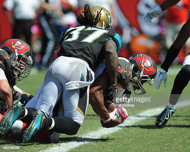 Running back Doug Martin of the Tampa Bay Buccaneers scores a touchdown in the second quarter against the Jacksonville Jaguars at Raymond James...