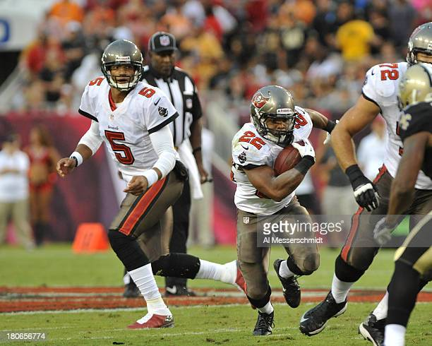 Running back Doug Martin of the Tampa Bay Buccaneers takes a handoff from quarterback Josh Freeman against the New Orleans Saints September 15 2013...