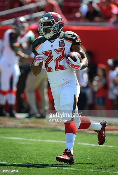 Running back Doug Martin of the Tampa Bay Buccaneers warms up before the game against the Jacksonville Jaguars at Raymond James Stadium on October 11...