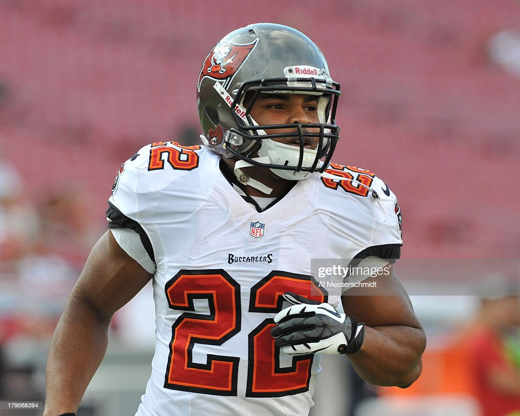 Running back Doug Martin #22 of the Tampa Bay Buccaneers warms up for play against the Washington Redskins August 29, 2013 at Raymond James Stadium in Tampa, Florida.