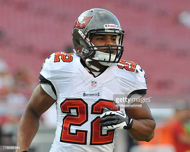 Running back Doug Martin of the Tampa Bay Buccaneers warms up for play against the Washington Redskins August 29 2013 at Raymond James Stadium in...