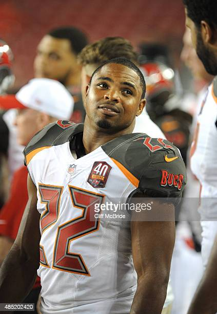 Running back Doug Martin of the Tampa Bay Buccaneers watches the game from the sidelines at Raymond James Stadium in preseason action on August 24...