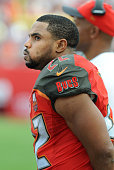 Running back Doug Martin of the Tampa Bay Buccaneers watches the game from the sidelines in the fourth quarter against the Chicago Bears at Raymond...
