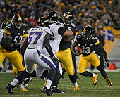 Running back Dri Archer of the Pittsburgh Steelers runs with the football as offensive linemen Maurkice Pouncey and Ramon Foster block linebacker CJ...