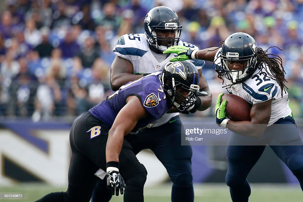 Running back <a gi-track='captionPersonalityLinkClicked' href=/galleries/search?phrase=DuJuan+Harris&family=editorial&specificpeople=5547092 ng-click='$event.stopPropagation()'>DuJuan Harris</a> #32 of the Seattle Seahawks carries the ball against inside linebacker <a gi-track='captionPersonalityLinkClicked' href=/galleries/search?phrase=Daryl+Smith&family=editorial&specificpeople=2097172 ng-click='$event.stopPropagation()'>Daryl Smith</a> #51 of the Baltimore Ravens in the third quarter at M&T Bank Stadium on December 13, 2015 in Baltimore, Maryland.