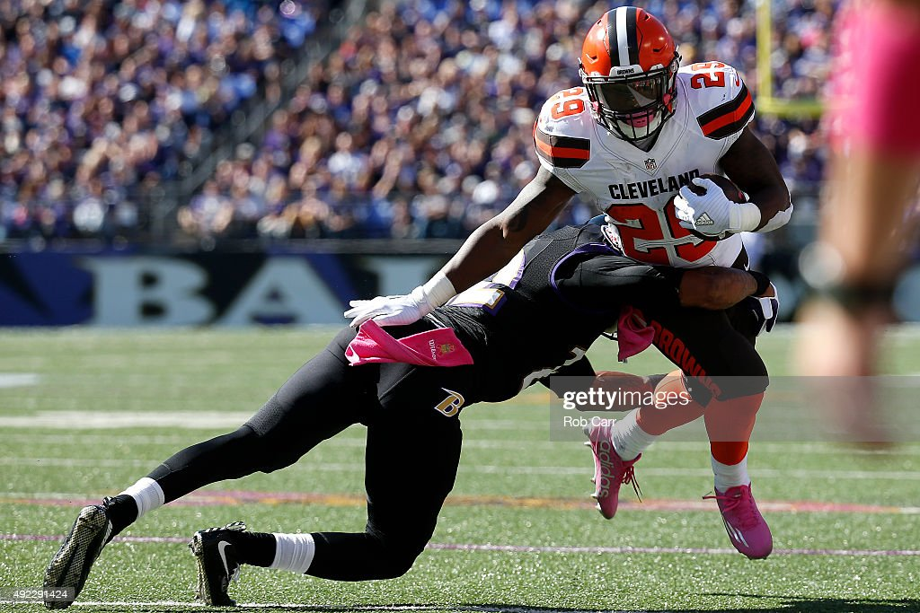 Running back <a gi-track='captionPersonalityLinkClicked' href=/galleries/search?phrase=Duke+Johnson+-+Football-Spieler&family=editorial&specificpeople=13981151 ng-click='$event.stopPropagation()'>Duke Johnson</a> #29 of the Cleveland Browns is tackled by cornerback <a gi-track='captionPersonalityLinkClicked' href=/galleries/search?phrase=Jimmy+Smith+-+Football-Cornerback&family=editorial&specificpeople=7734272 ng-click='$event.stopPropagation()'>Jimmy Smith</a> #22 of the Baltimore Ravens in the second quarter of a game at M&T Bank Stadium on October 11, 2015 in Baltimore, Maryland.