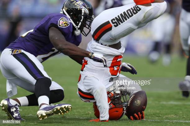 Running back Duke Johnson of the Cleveland Browns makes a catch as free safety Lardarius Webb of the Baltimore Ravens tries to stop him in the third...