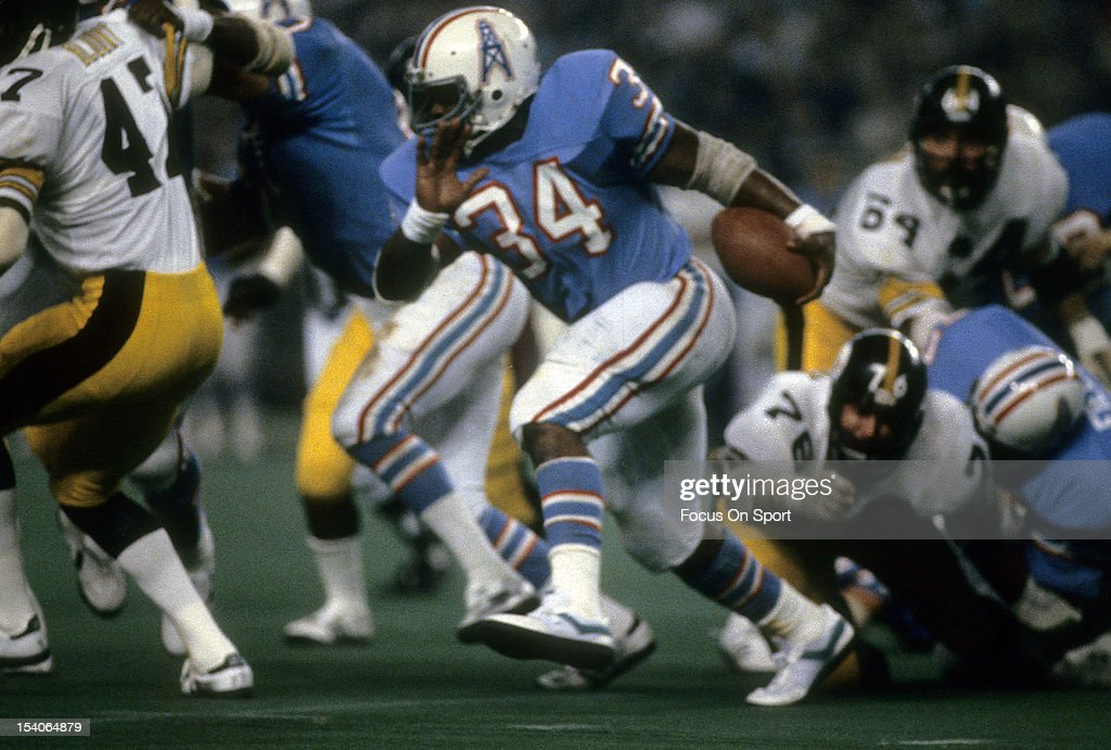 Running Back <a gi-track='captionPersonalityLinkClicked' href=/galleries/search?phrase=Earl+Campbell&family=editorial&specificpeople=570909 ng-click='$event.stopPropagation()'>Earl Campbell</a> #34 of the Houston Oilers carries the ball against the Pittsburgh Steelers during an NFL football game December 4, 1980 at the Houston Astro Dome in Houston, Texas. Campbell played for the Oilers from 1978-84.