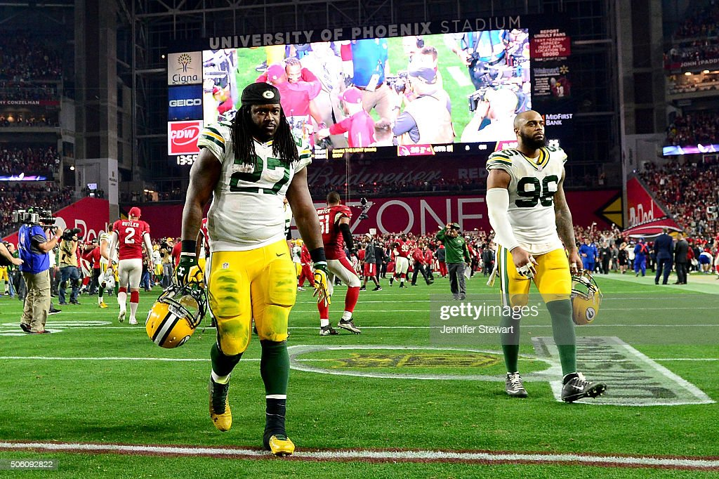 Running back <a gi-track='captionPersonalityLinkClicked' href=/galleries/search?phrase=Eddie+Lacy&family=editorial&specificpeople=6902550 ng-click='$event.stopPropagation()'>Eddie Lacy</a> #27 and defensive end outside linebacker <a gi-track='captionPersonalityLinkClicked' href=/galleries/search?phrase=Mike+Neal+-+American+Football+Player&family=editorial&specificpeople=11464524 ng-click='$event.stopPropagation()'>Mike Neal</a> #96 of the Green Bay Packers walk off the field after losing in overtime to the Arizona Cardinals 26-20 in the NFC Divisional Playoff Game at University of Phoenix Stadium on January 16, 2016 in Glendale, Arizona.