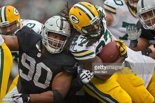 Running back Eddie Lacy of the Green Bay Packers come square up against defensive tackle Dan Williams of the Oakland Raiders in the second quarter on...