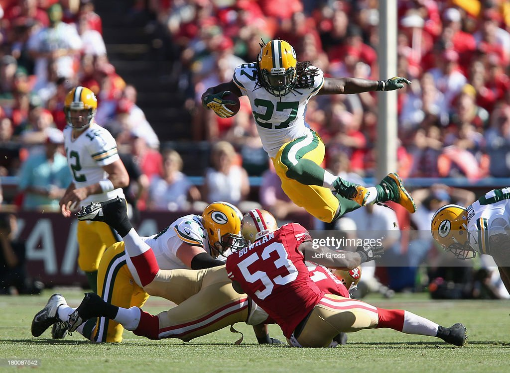 Running back <a gi-track='captionPersonalityLinkClicked' href=/galleries/search?phrase=Eddie+Lacy&family=editorial&specificpeople=6902550 ng-click='$event.stopPropagation()'>Eddie Lacy</a> #27 of the Green Bay Packers leaps over NaVorro Bowman #53 of the San Francisco 49ers in the fourth quarter at Candlestick Park on September 8, 2013 in San Francisco, California. The 49ers defeated the Packers 34-28.