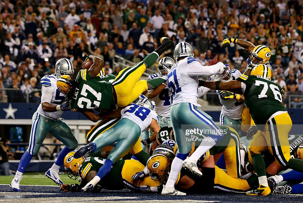 Running back Eddie Lacy of the Green Bay Packers scores a fourth quarter touchdown against the Dallas Cowboys during a game at ATT Stadium on...