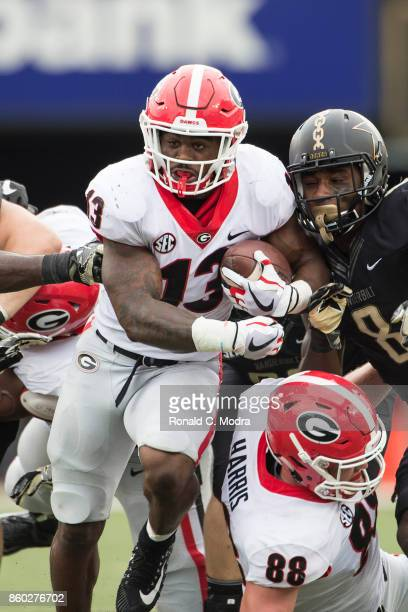 Running back Elijah Holyfield of the Georgia Bulldogs carries the ball during a game against the Vanderbilt Commodores at Vanderbilt Stadium on...