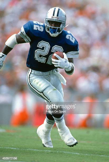 Running Back Emmitt Smith of the Dallas Cowboys carries the ball during the NFL Football game circa 1990 Smith played for the Cowboys from 199002