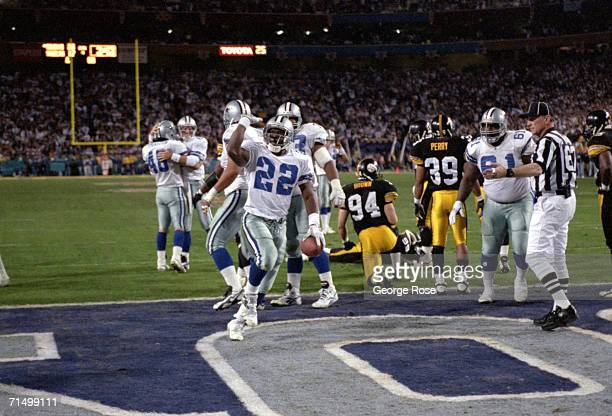 Running back Emmitt Smith of the Dallas Cowboys celebrates after scoring a touchdown during Super Bowl XXX against the Pittsburgh Steelers at Sun...