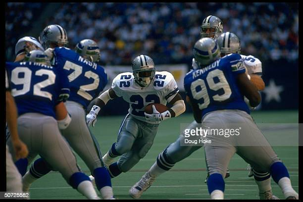Running back Emmitt Smith of the Dallas Cowboys runs against the Seattle Seahawks defense during a game on October 11 1992 at Texas Stadium in Irving...