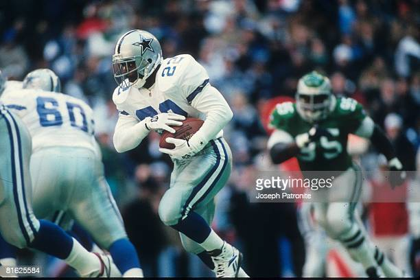 Running back Emmitt Smith of the Dallas Cowboys runs upfield against the Philadelphia Eagles at Texas Stadium in the 1995 NFC Divisional Playoff Game...